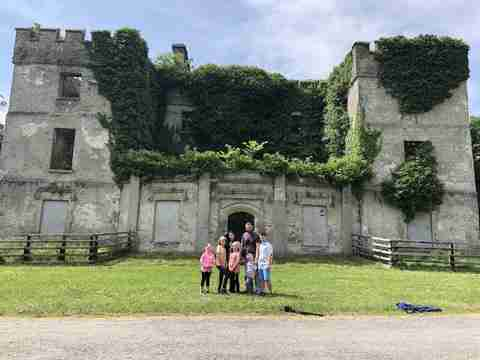 Leah and her family stood in front of an old castle