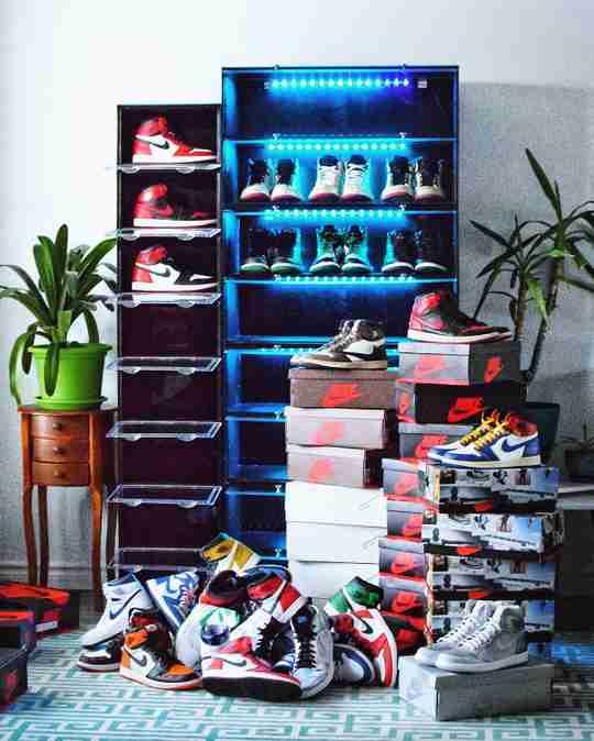 Loading Up His Sneaker Throne - Chris Chiu