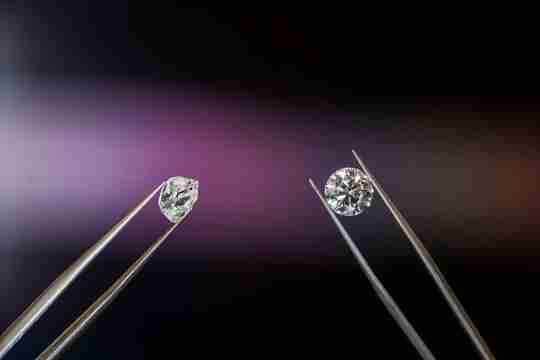 Round cut diamond being examined