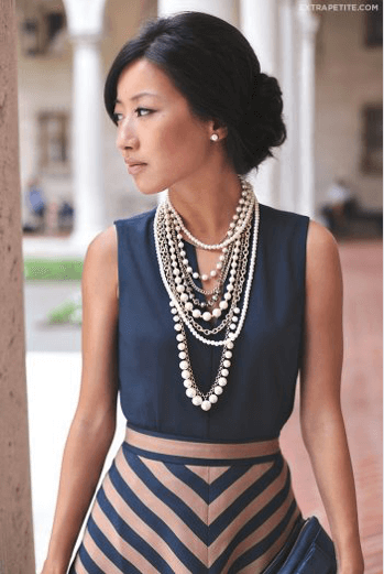 elegant woman wearing pearl necklaces