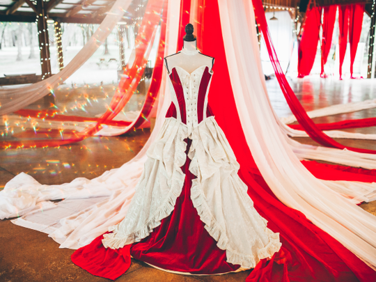 The ivory and red wedding corset gown Gallery Serpentine in Australia made for Julia Louisa DeJoseph-Moellmann for her nov 2019 The Greatest Showman themed wedding