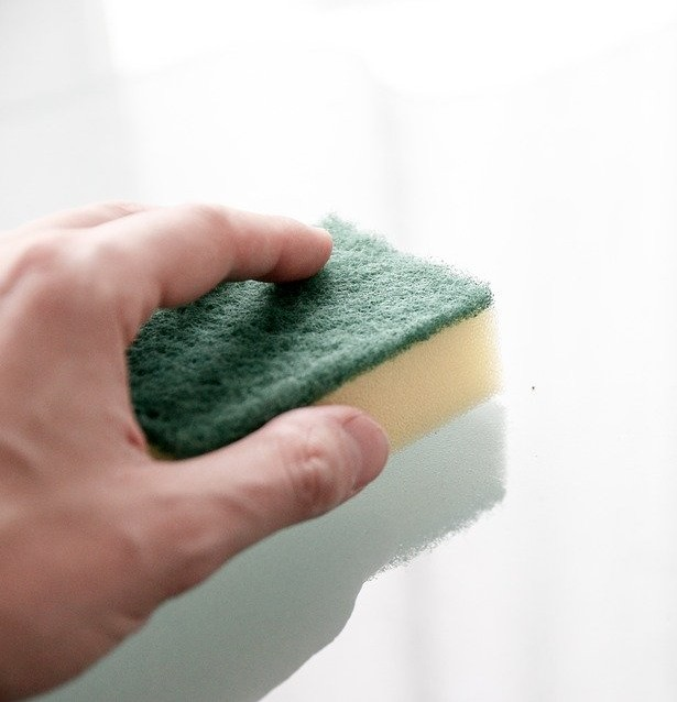 wipe laundry hamper clean with sponge