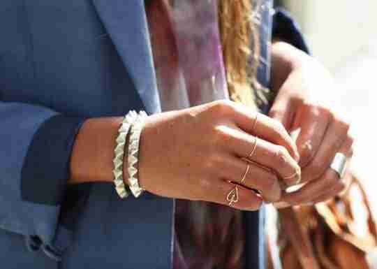 woman in blue blazer and gold accessories