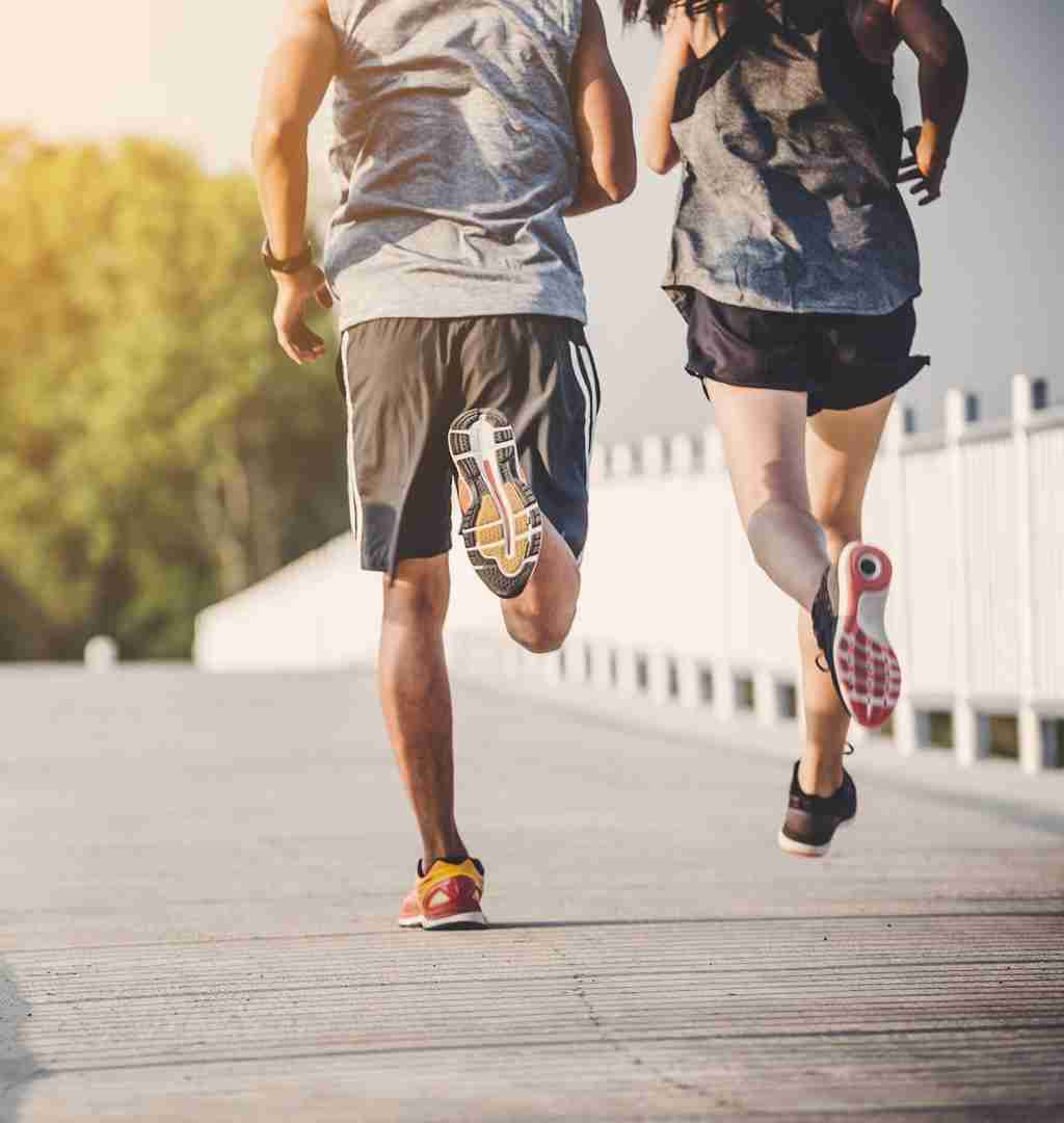 Two adults jogging in the morning.