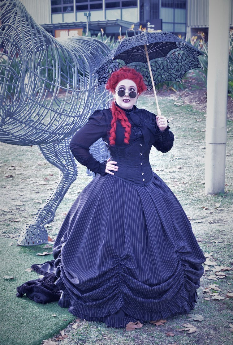 Rhiannon underpinned the Pinstripe Victorian Wedding Dress skirt with her own bell shaped hoop and wore our Black Victorian Blouse under the Underbust Victorian corset