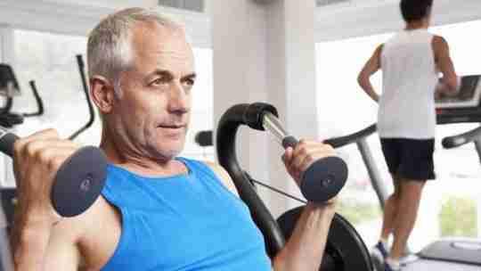 Man Exercising In Gym Man Running On Treadmill