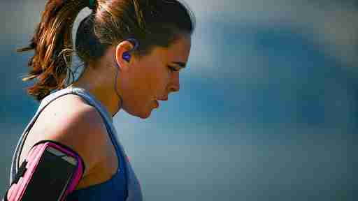 girl listening to music and cooling down after a run