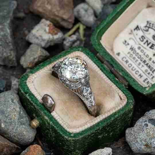 A diamond engagement ring in an antique ring box