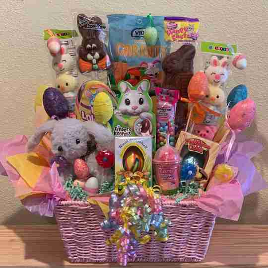 A big gift basket full of candy and gifts.