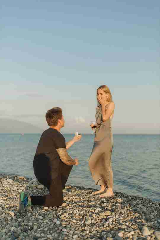 A man proposing to a woman at the beach
