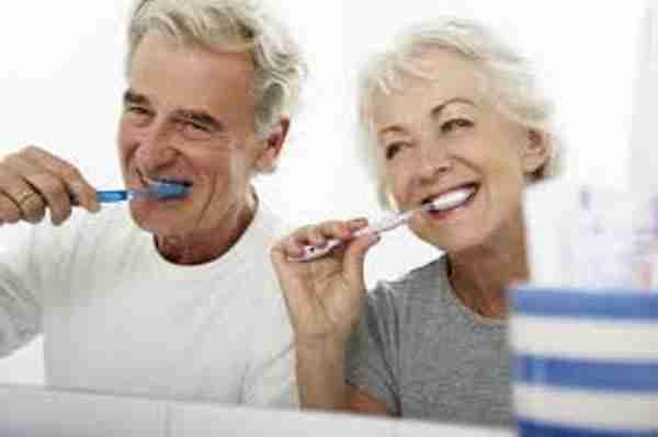 Older Couple Old People Brushing Teeth in Bathroom