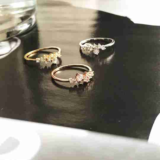 Three yellow gold, rose gold, and sterling silver rings