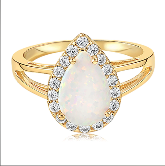 Gold ring with an opal center stone and a crown head with multiple gemstones surrounding the main stone