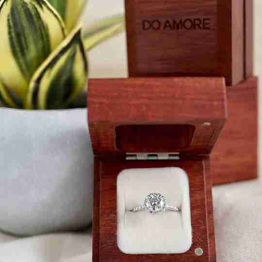 A Do Amore ring in a sustainable wood box