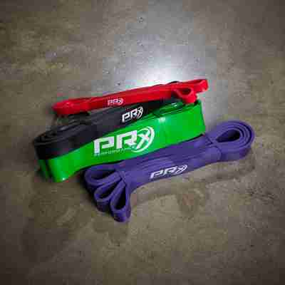 PRx Mobility band pack - Red, Black, Purple and Green mobility bands on concrete
