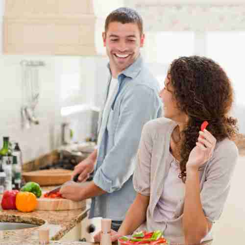 man and woman preparing healthy meal