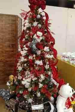 A Christmas tree with a teddy bear.