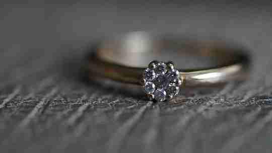 Diamond ring on fabric.