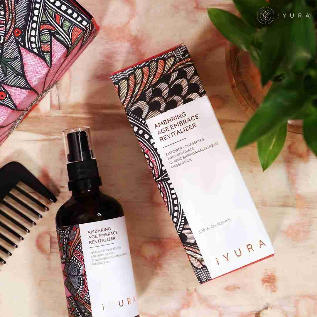 iYURA Ambhring with its beautiful Madhubani painting packaging and a comb.