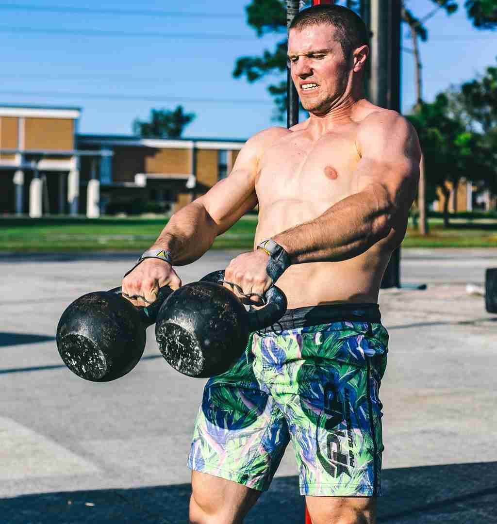 CrossFit athlete working out with kettlebells while increasing his work capacity.