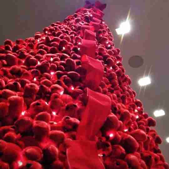 A big Christmas tree made from red bears.
