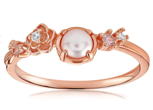 Rose gold vermeil ring with gems on each side of the pearl center stone