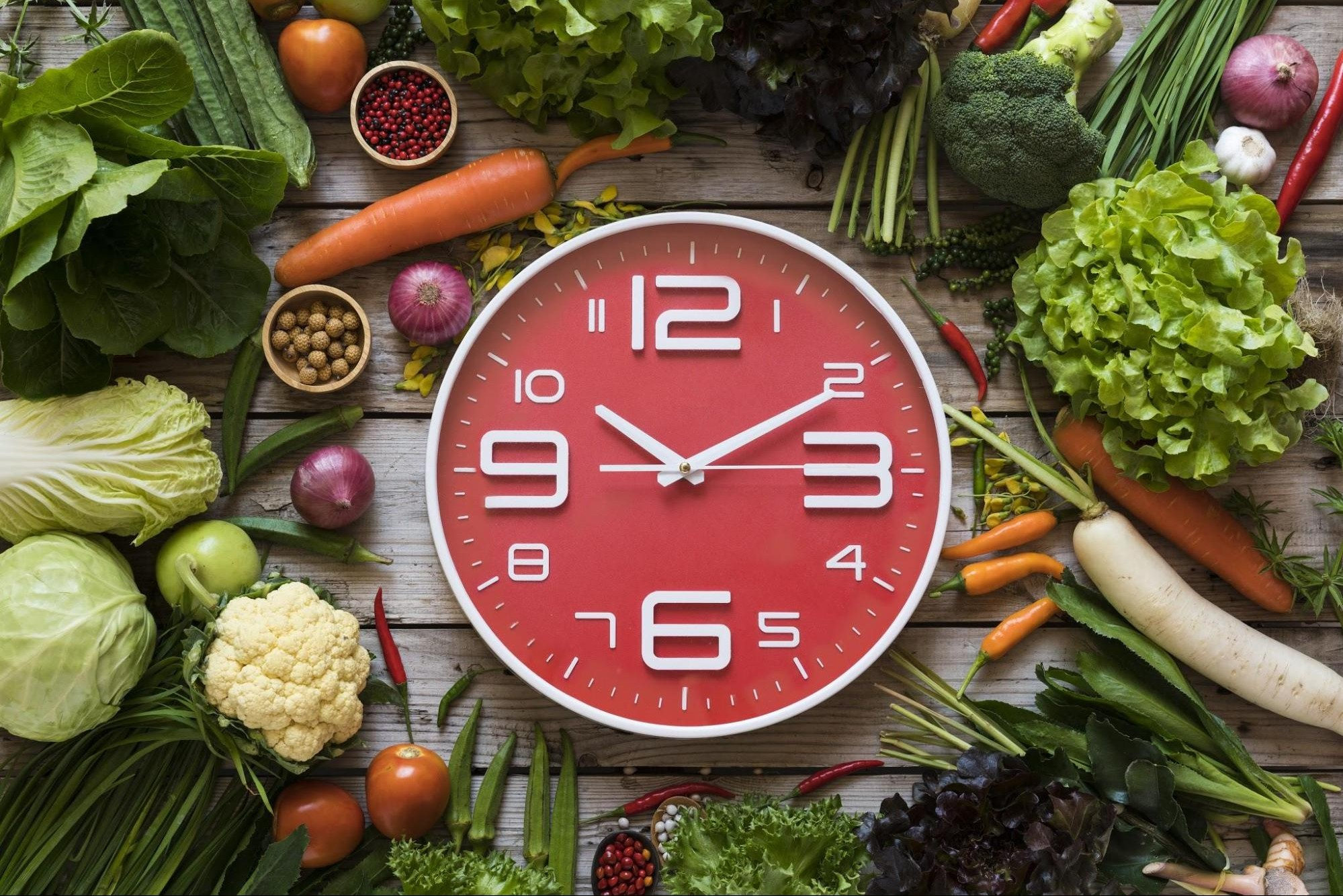 clock with vegetables for intermittent fasting
