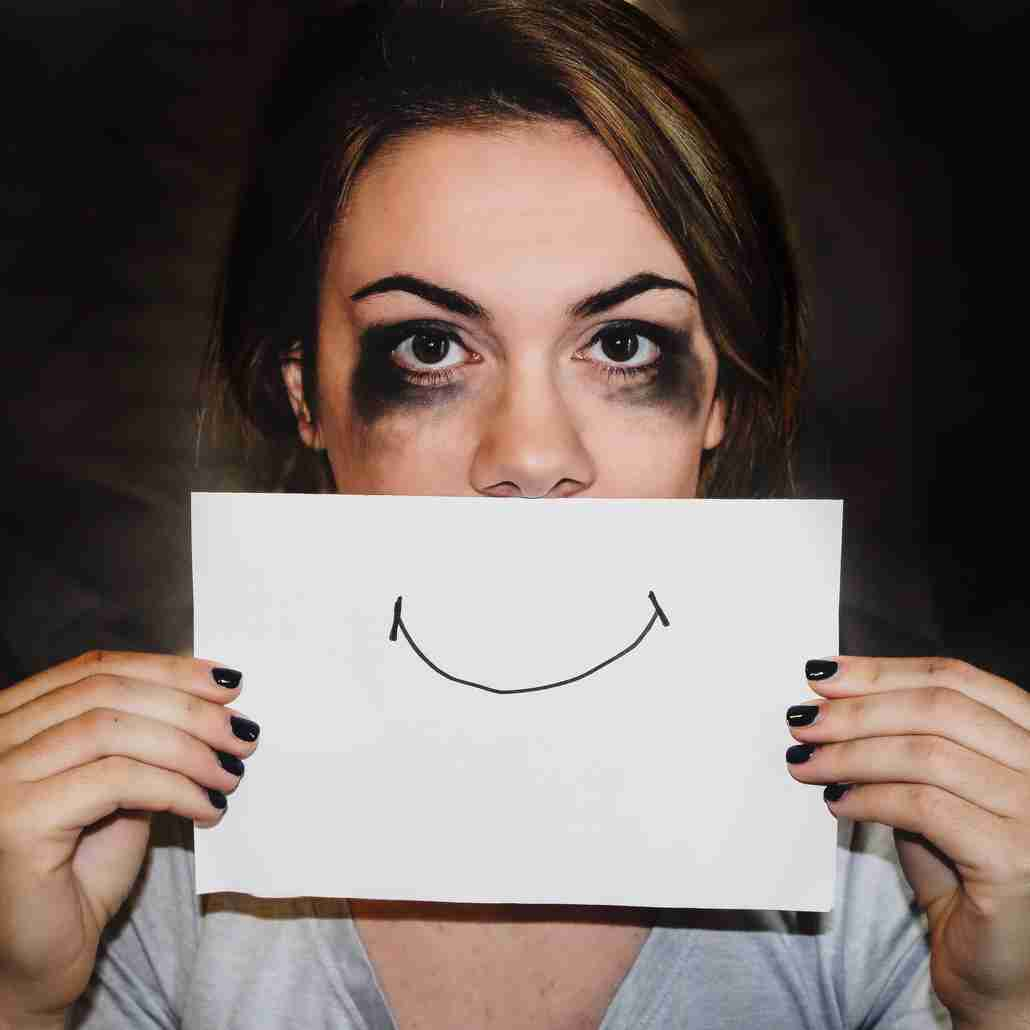 Woman Holding Smiling Face Sign