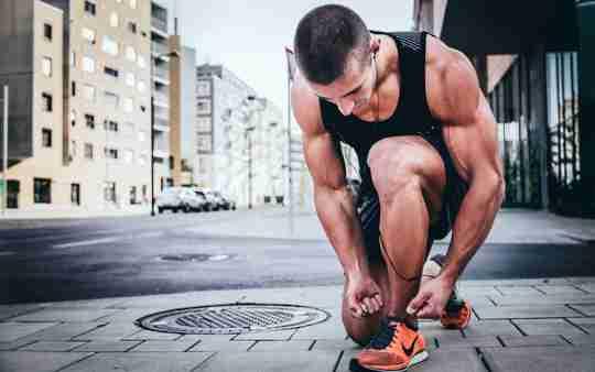 Guy Tying Running Shoes