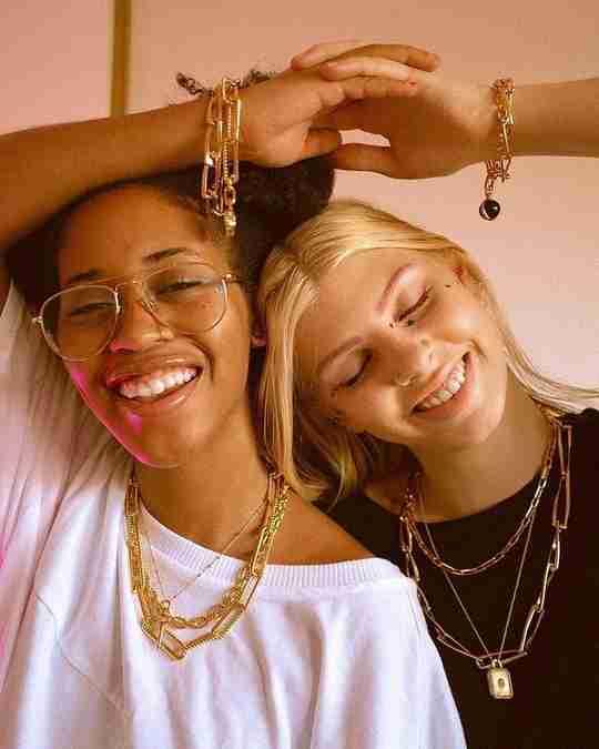 Two women wearing Missoma jewelry
