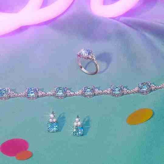 A ring, necklace, and set of earrings made of blue Swarovski crystal