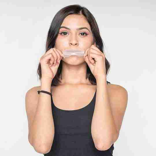 Woman With Tape on Mouth White Background