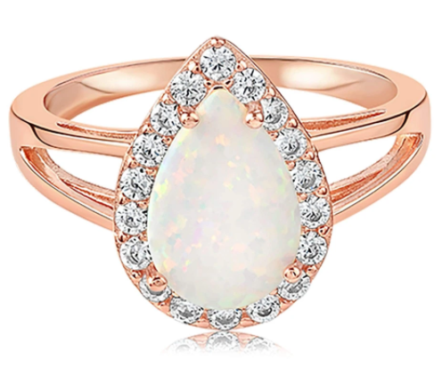 Rose gold ring vermeil with an opal center stone and a crown head with multiple gemstones surrounding the main stone