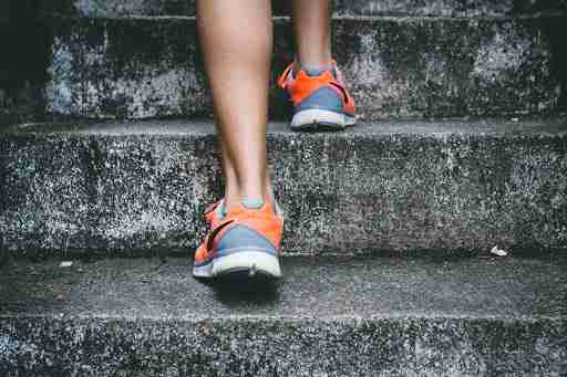 walking up stairs in tennis shoes health healthy walk