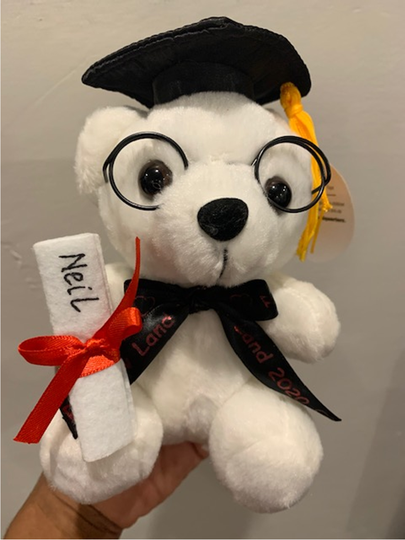 A white graduation bear