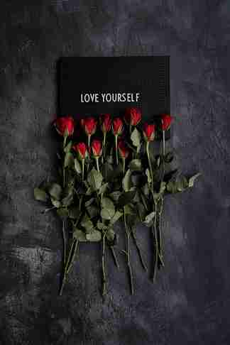 Roses with a love yourself sign