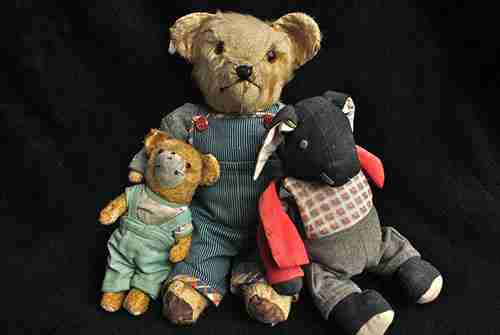 A group of antique teddy bears.