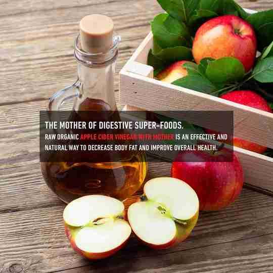 Mother of Digestive Super-Foods Apple Cider Vinegar with Mother Apples On Wood