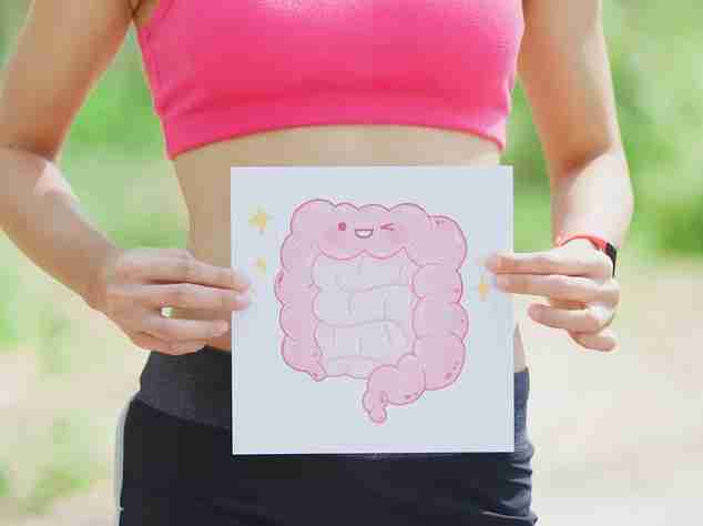 A woman holding a picture of intestines