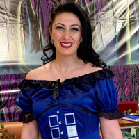 Donna from the Daily Grind Cafe Cronulla at her Dr Who & Harry Potter themed birthday wearing a Tardis gown by Gallery Serpentine