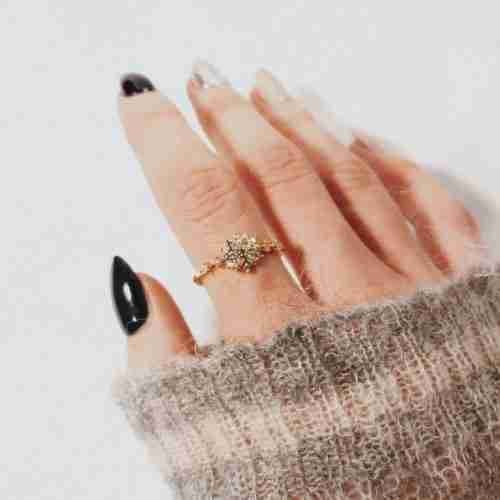 A woman wearing the Sophia Snowflake Ring with cubic zirconia stones