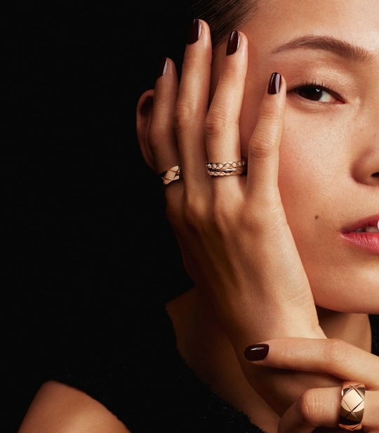 A woman wearing a Chanel ring
