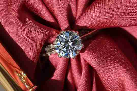 Large diamond ring on red cloth