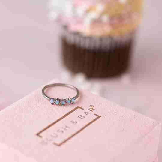 Blush and Bar opal ring with cupcake in the background