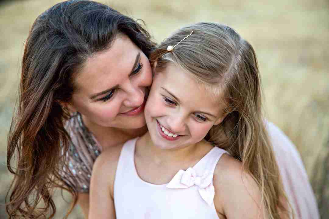 Mom smiling with daughter
