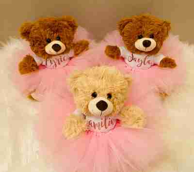 Three bears dresseed in pink tutus