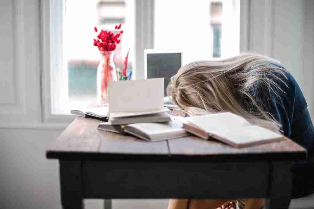 girl falling asleep at desk fatigued no energy