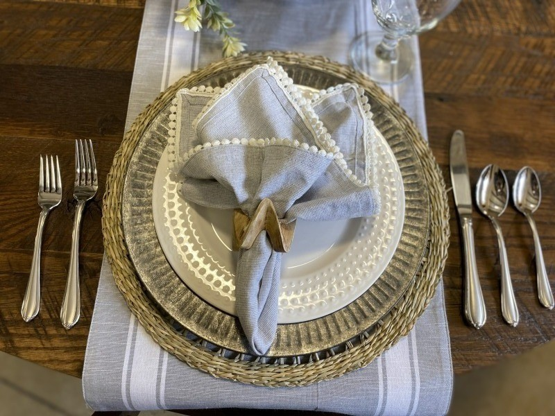 spring place setting galvanized charger with white napkin trim
