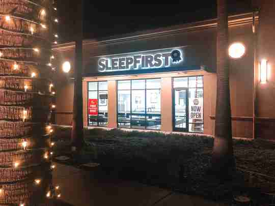 Sleep First Folsom mattress store in California with holiday lights in December, 2020