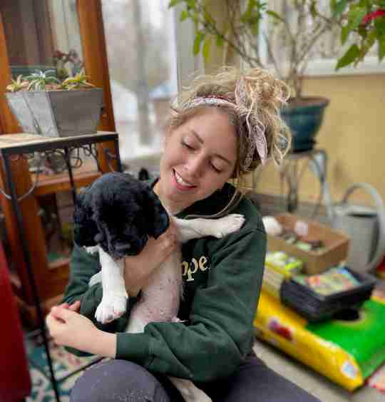 Meet Mary - holding dog